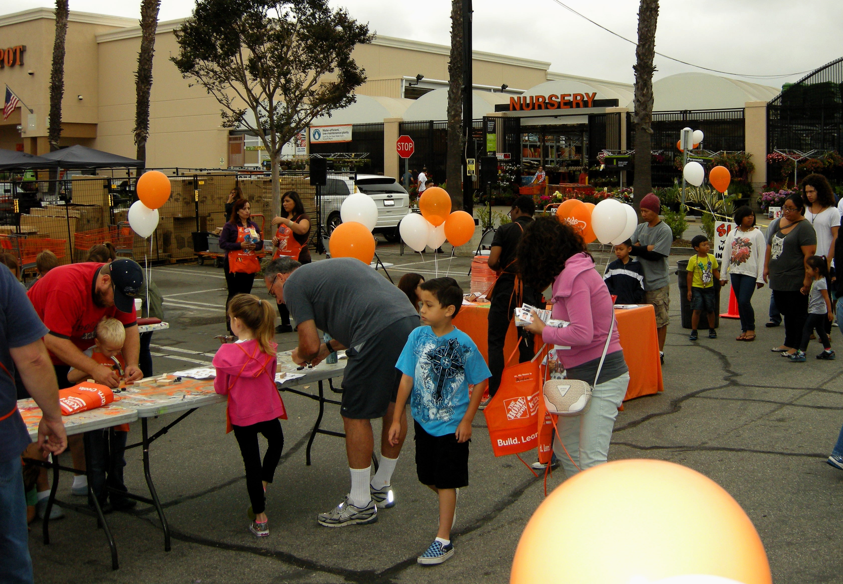 Families taking part in the Home Depot workshops
