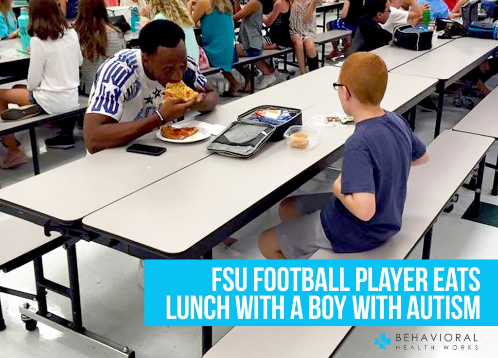 FSU Travis Rudolph eats lunch with boy with autism