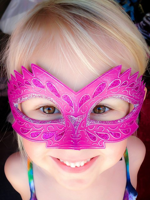 Girl in Mardi Gras Mask